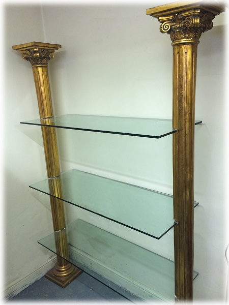 Tall golden columns display unit